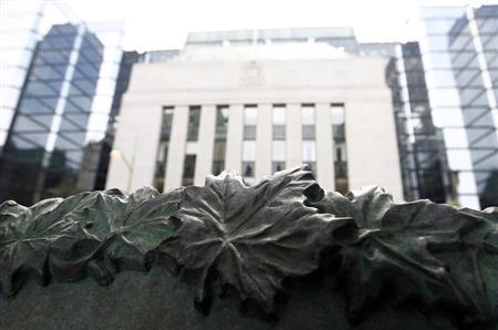 A sign framed by maple leaves is pictured in front of the Bank of Canada building in Ottawa July 17, 2012. REUTERS/Chris Wattie