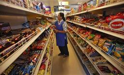 A worker arranges food packets inside a retail store in Kolkata October 24, 2013. REUTERS/Rupak De Chowdhuri