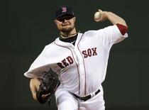 Oct 23, 2013; Boston, MA, USA; Boston Red Sox starting pitcher Jon Lester throws a pitch against the St. Louis Cardinals in the first inning during game one of the MLB baseball World Series at Fenway Park. Charles Krupa/Pool Photo via USA TODAY Sports