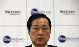 Mizuho Financial Group President and CEO Yasuhiro Sato speaks during a news conference on the merging of Mizuho Bank and Mizuho Corporate Bank in Tokyo July 1, 2013. REUTERS/Issei Kato