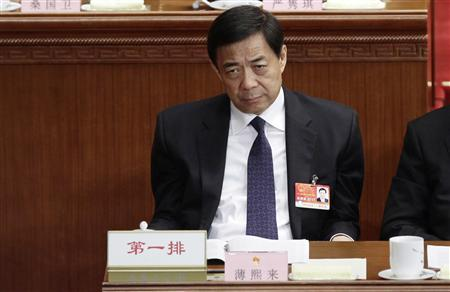 Former China's Chongqing Municipality Communist Party Secretary Bo Xilai pauses as he attends a plenary meeting of China's parliament, the National People's Congress, at the Great Hall of the People in Beijing in this March 10, 2011 file photo. REUTERS/Jason Lee/Files