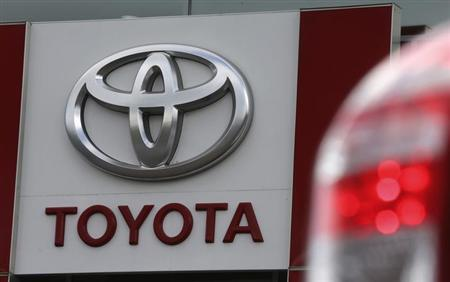 A sign with a logo is on display at a Toyota car sales and showroom in St. Petersburg, September 18, 2013. REUTERS/Alexander Demianchuk/Files