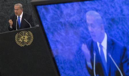 Israel's Prime Minister Benjamin Netanyahu, also seen on a television monitor, addresses the 68th session of the United Nations General Assembly in New York October 1, 2013. REUTERS/Adrees Latif