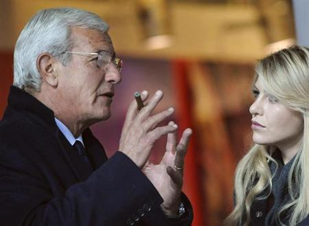 Italian coach Marcello Lippi (L) talks with Barbara Berlusconi, the daughter of Italian Prime Minister Silvio Berlusconi, before of the Italian Serie A soccer match between AC Milan and Palermo at San Siro stadium in Milan November 10, 2010. REUTERS/Giorgio Perottino/Files