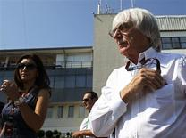 Formula One supremo Bernie Ecclestone (R) is pictured during the third practice session of the Hungarian F1 Grand Prix at the Hungaroring circuit in Mogyorod, near Budapest July 27, 2013. REUTERS/Laszlo Balogh
