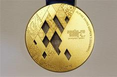 The gold medal for the 2014 Winter Paralympic Games in Sochi, in the alpine skiing women's downhill category, is seen on display during a presentation in St. Petersburg in this May 30, 2013 file photo. REUTERS/Alexander Demianchuk/Files