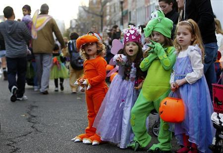 Children participate in the annual Ragamuffin Halloween Parade, postponed by Hurricane Sandy, in Hoboken, New Jersey November 12, 2012. REUTERS/Gary Hershorn