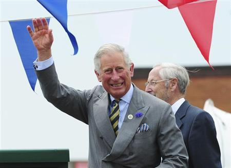 Britain's Prince Charles waves to the crowd during a visit to the harbour in Bridlington, northern England July 23, 2013. REUTERS/Anna Gowthorpe/POOL