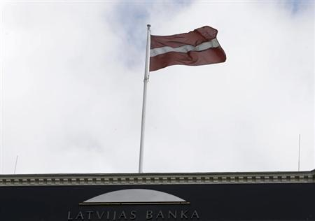 Latvia's national flag waves over the Central Bank building in Riga July 9, 2013. REUTERS/Ints Kalnins