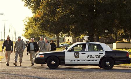 Major General Terry M. ''Max'' Haston (2nd L), Adjutant General Tennessee National Guard tours the scene of a shooting at the National Guard Armory in Millington, Tennessee October 24, 2013. REUTERS/Justin Shaw