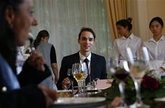 Guillaume, a French student takes part in a conversation role during a session on English dining during the Intensive Etiquette Courses at the Institut Villa Pierrefeu in Glion near Montreux, western Switzerland, October 22, 2013. REUTERS/Denis Balibouse
