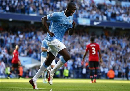 Manchester City's Yaya Toure celebrates scoring against Manchester United during their English Premier League soccer match at the Etihad Stadium in Manchester, northern England, September 22, 2013. REUTERS/Darren Staples