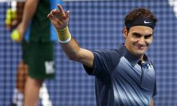 Switzerland's Roger Federer waves after winning his quarter final match against Grigor Dimitrov of Bulgaria at the Swiss Indoors ATP tennis tournament in Basel October 25, 2013. REUTERS/Arnd Wiegmann