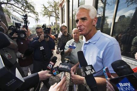 Former Florida Republican Governor Charlie Crist, who campaigned for U.S. President Barack Obama in the 2012 presidential election, speaks to the media outside the Pinellas County Supervisor of Elections office after officially switching his party affiliation to Democrat, in St. Petersburg, Florida, December 13, 2012. REUTERS/Steve Nesius