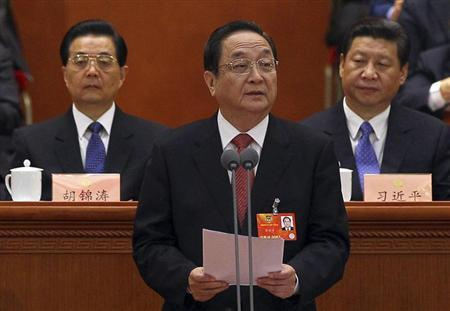 Newly elected chairman of the National Committee of the Chinese People's Political Consultative Conference (CPPCC), Yu Zhengsheng (C), speaks as China's President Hu Jintao (L) and General Secretary of the Central Committee of the Communist Party of China (CPC) Xi Jinping look on during the closing ceremony of the CPPCC at the Great Hall of the People in Beijing March 12, 2013. REUTERS/China Daily