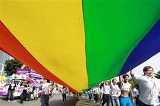Participants hold a giant rainbow flag during the Taiwan LGBT Pride Parade in Taipei October 26, 2013. REUTERS/Pichi Chuang