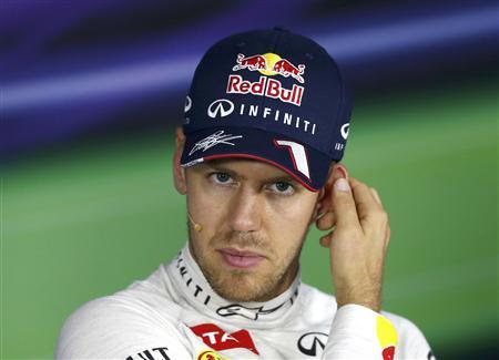 Red Bull Formula One driver Sebastian Vettel of Germany attends a news conference after the qualifying session of the Indian F1 Grand Prix at the Buddh International Circuit in Greater Noida, on the outskirts of New Delhi, October 26, 2013. REUTERS/Ahmad Masood
