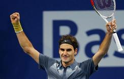Switzerland's Roger Federer reacts after winning his semi-final match against Vasek Pospisil of Canada at the Swiss Indoors ATP tennis tournament in Basel October 26, 2013. REUTERS/Arnd Wiegmann