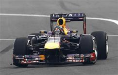 Red Bull Formula One driver Sebastian Vettel of Germany drives during the Indian F1 Grand Prix at the Buddh International Circuit in Greater Noida, on the outskirts of New Delhi, October 27, 2013. REUTERS/Adnan Abidi