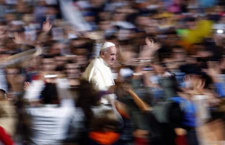 Pope Francis leaves at the end of his special audience with families at St. Peter Square in Vatican October 26, 2013. REUTERS/Alessandro Bianchi