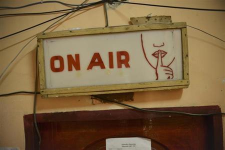 An on-air sign is seen at a radio station in Mogadishu December 8, 2012. REUTERS/AU-UN IST Photo/Tobin Jones/Handout