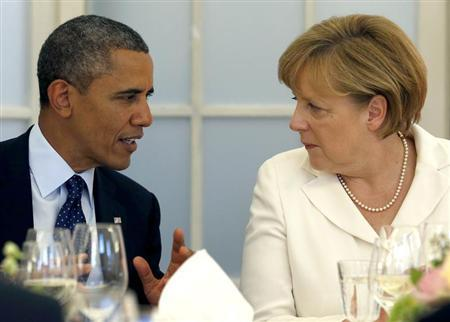 U.S. President Barack Obama and German Chancellor Angela Merkel (R) chat during at the Chralottenburg Castle in Berlin June 19, 2013. REUTERS/Michael Sohn/Pool