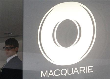 A security worker stands next to the Macquarie Group logo in central Sydney February 9, 2010. REUTERS/Daniel Munoz