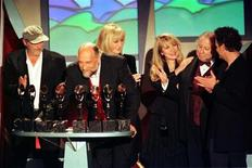 Members of the band Fleetwod Mac appear at the podium after being inducted into the Rock and Roll Hall of Fame at the Rock and Roll Hall of Fame Foundation's Thirteenth Annual Induction Dinner at New York's Waldorf Astoria Hotel, January 12. From left are John McVie, Mick Fleetwood, Christine McVie, Stevie Nicks, Peter Green and Lindsey Buckingham. REUTERS/Mike Segar