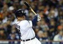 Detroit Tigers third baseman Miguel Cabrera (24) hits an RBI single against the Boston Red Sox during the fourth inning in game four of the American League Championship Series baseball game at Comerica Park. Mandatory Credit: Rick Osentoski-USA TODAY Sports