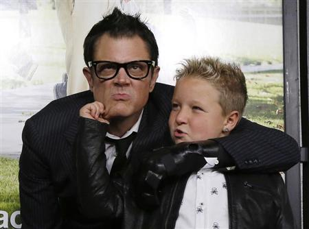 Cast member Johnny Knoxville (L) poses with co-star Jackson Nicoll at the premiere of ''Jackass Presents: Bad Grandpa'' in Hollywood, California October 23, 2013. REUTERS/Mario Anzuoni