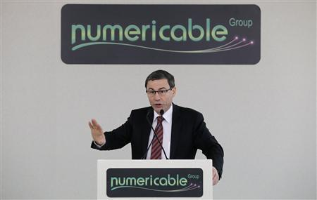 French cable operator Numericable CEO Eric Denoyer attends a news conference in Paris, October 28, 2013. REUTERS/Christian Hartmann