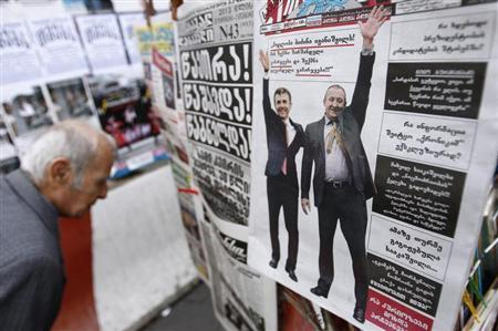 A newspaper displayed on a stand shows images of Georgian Prime Minister Bidzina Ivanishvili (L) and presidential candidate Georgy Margvelashvili from the ruling Georgian Dream coalition, in Tbilisi, October 28, 2013. REUTERS/David Mdzinarishvili