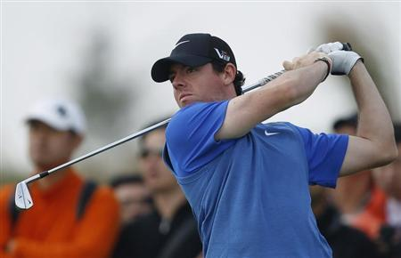 Rory McIlroy of Northern Ireland tees off on the second hole during the BMW Masters 2013 golf tournament at Lake Malaren Golf Club in Shanghai October 26, 2013. REUTERS/Aly Song