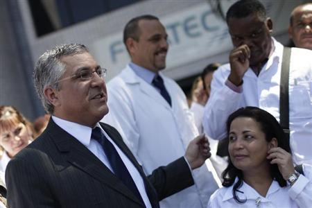 Brazil's Minister of Health Alexandre Padilha reacts after a conference for foreign doctors at the University of Brasilia August 26, 2013. REUTERS/Ueslei Marcelino