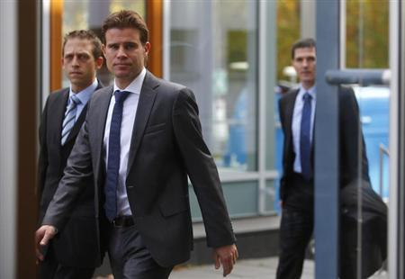 Bundesliga referee Felix Brych and his assistant referees Mark Borsch (L) and Stefan Lupp (R) arrive for a hearing at the German soccer association sports court (DFB Sportgericht) at the DFB headquarters in Frankfurt October 28, 2013. REUTERS/Kai Pfaffenbach