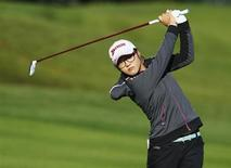 Lydia Ko of New Zealand hits an approach shot onto the 15th hole during the first round of the women's Evian Championship golf tournament in Evian September 13, 2013. REUTERS/Denis Balibouse