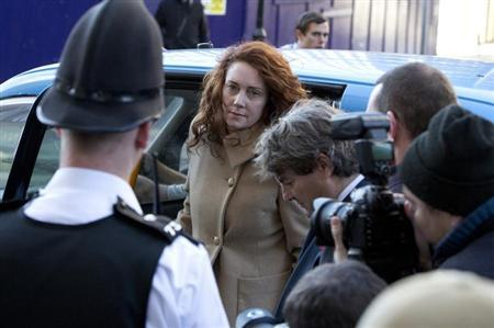 Former News International chief executive Rebekah Brooks arrives with her husband Charlie at the Old Bailey courthouse in London October 28, 2013. REUTERS/Neil Hall