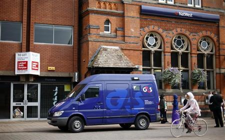 A G4S security van is parked outside a bank in Loughborough, central England, August 28, 2013. REUTERS/Darren Staples