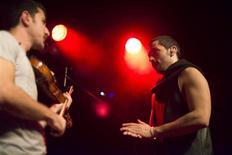 Hamed Sinno (R), the lead singer of Lebanese alternative rock band Mashrou' Leila is seen performing in London October 8, 2013. REUTERS/Shadi Bushra