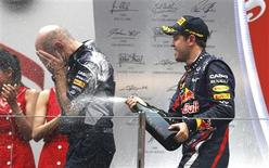 Red Bull Formula One driver Sebastian Vettel of Germany (R) sprays Red Bull technical chief Adrian Newey after the Indian F1 Grand Prix at the Buddh International Circuit in Greater Noida, on the outskirts of New Delhi, October 27, 2013. REUTERS/Adnan Abidi