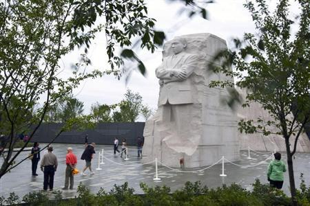 Tourists visit the Martin Luther King Memorial in Washington August 28, 2011. REUTERS/Benjamin Myers