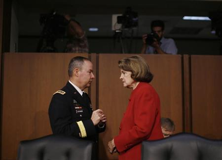 U.S. Senate (Select) Intelligence Committee Chairwoman Dianne Feinstein (D-CA)(R) speaks with National Security Agency Director General Keith Alexander before his testimony at a Senate Intelligence Committee hearing the Foreign Intelligence Surveillance Act legislation on Capitol Hill in Washington, September 26, 2013. REUTERS/Jason Reed