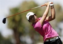 Fifteen-year old Lydia Ko of New Zealand tees off on the 12th hole during the third round of the Kraft Nabisco Championship LPGA golf tournament in Rancho Mirage, California, April 6, 2013. REUTERS/Danny Moloshok