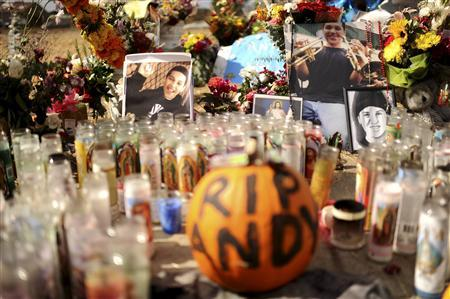 Candles and photographs form a memorial in a vacant lot where 13-year-old Andy Lopez Cruz was shot and killed by sheriff's deputies on Tuesday in Santa Rosa, California October 27, 2013. REUTERS-Noah Berger