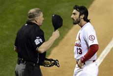 St. Louis Cardinals second baseman Matt Carpenter (13) argues with home plate umpire Bill Miller (left) after striking out against the Boston Red Sox in the third inning during game five of the MLB baseball World Series at Busch Stadium. Mandatory Credit: Eileen Blass-USA TODAY Sports