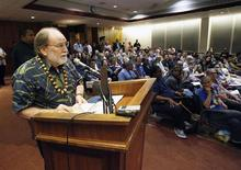Hawaii Governor Neil Abercrombie reads a quote from the Dalai Lama as he gives testimony in support of same sex marriage during a Senate hearing at the Hawaii State Capital in Honolulu October 28, 2013. REUTERS/Hugh Gentry