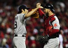 Oct 28, 2013; St. Louis, MO, USA; Boston Red Sox relief pitcher Koji Uehara (19) celebrates with catcher David Ross (rich) after defeating the St. Louis Cardinals in game five of the MLB baseball World Series at Busch Stadium. The Red Sox won 3-1. Mandatory Credit: Jeff Curry-USA TODAY Sports