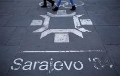 People walk past the logo of the Winter Olympics in Sarajevo, painted on the streets in central Sarajevo October 27, 2013. REUTERS/Dado Ruvic