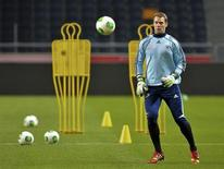 Germany's goalkeeper Manuel Neuer takes part in a soccer training session at Friends Arena in Stockholm October 14, 2013. REUTERS/Jonas Ekstromer/TT News Agency