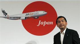 Presidente-executivo da Japan Airlines, Masaru Onishi, antes de coletiva de imprensa conjunta com o Grupo Jetstar, em Tóquio. A Japan Airlines (JAL) começará a considerar trocas em sua frota de jatos Boeing 373 em 2014 e está buscando propostas tanto da Boeing quando da Airbus, disse o presidente do Conselho da empresa na terça-feira. 16/08/2011. REUTERS/Issei Kato